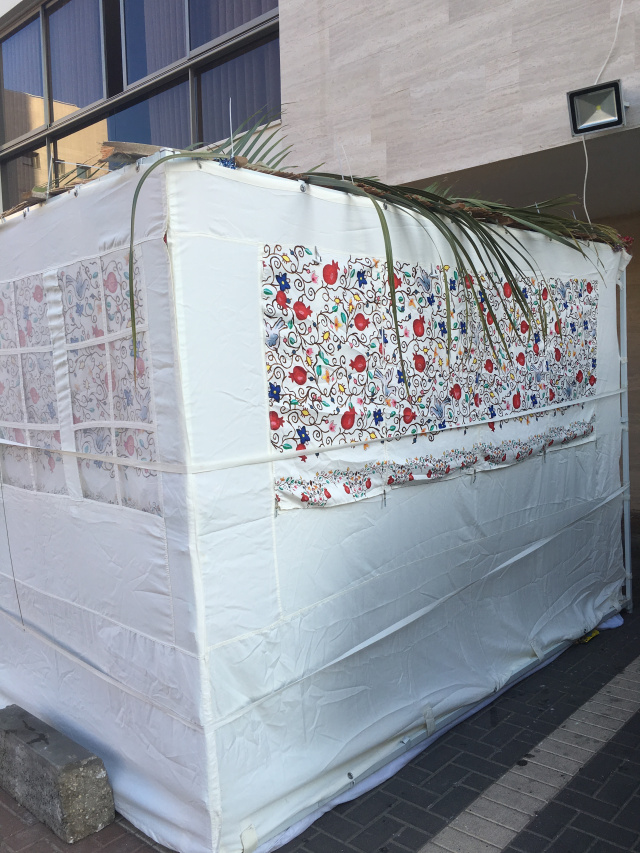 Ashdod, Israel. A sukkah in the parking lot.
